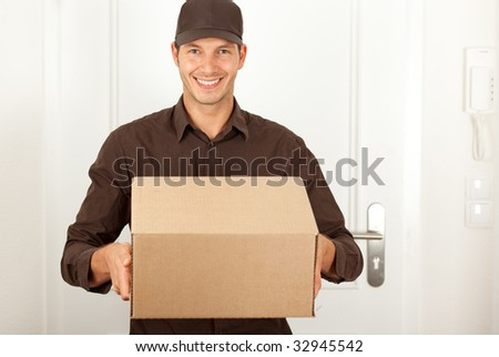 Handsome masculine postman in brown formal clothes shipping deliver a cardbox cartoon - stock photo