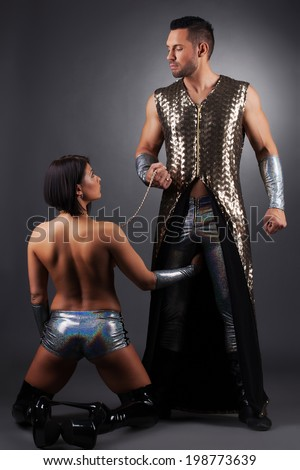 Handsome master keeps his sexual slave in chains