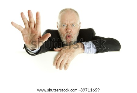Handsome mature business man saying no behind empty banner on white background