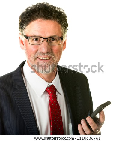 Handsome mature business man wearing glasses and smiling while using a smart phone isolated on white.