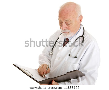 Handsome mature doctor making notations in a patients chart.  Isolated on white. - stock photo