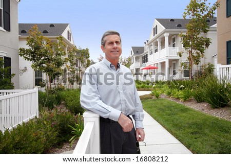 Handsome Mature Man And Houses - stock photo