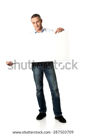 Handsome mature man holding an empty banner. - stock photo