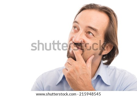 Handsome mature man looking up - stock photo