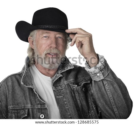 Handsome mature man wearing a gray jeans jacket and black felt cowboy hat with blue eyes - stock photo