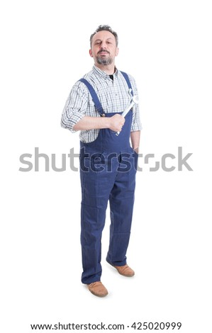 Handsome mechanic or repairman with spanner standing and posing confident as pride or winner concept isolated on white - stock photo