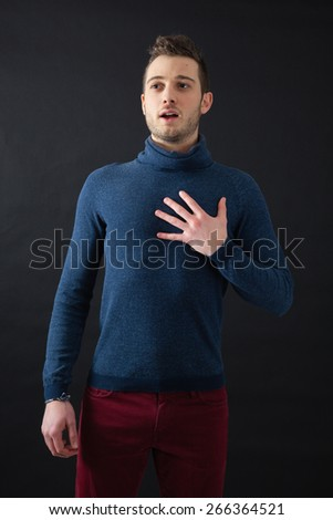 Handsome men doing different expressions in different sets of clothes: heart attack - stock photo