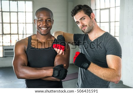 Handsome men pose after exercise fitness class mixed martial arts training instructor