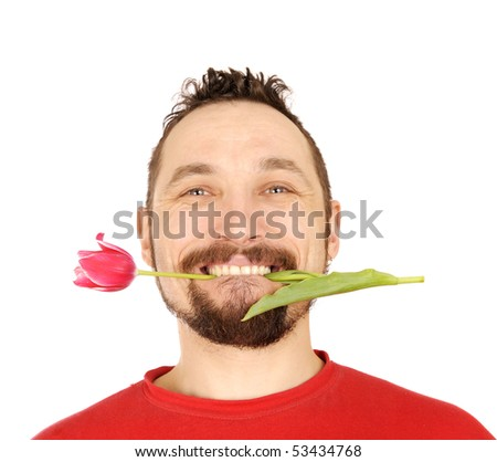 handsome men with the pink tulip in his teeth