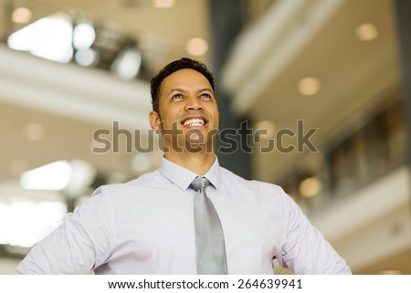 handsome mid age business executive looking up - stock photo