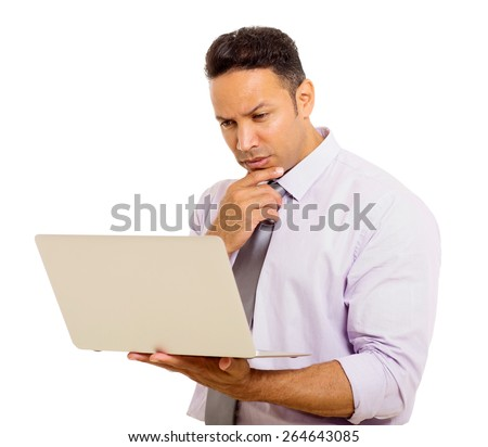 handsome mid age businessman reading email on his laptop - stock photo