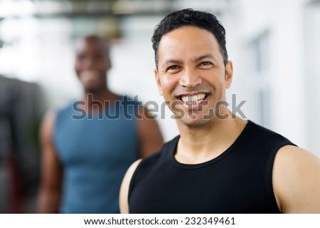 handsome mid age male gym trainer closeup portrait - stock photo