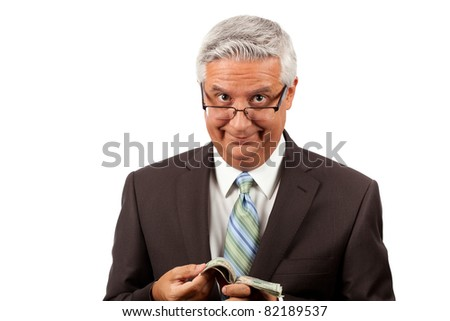 Handsome middle age business man wearing a suit and glasses counting his money on a white background. - stock photo