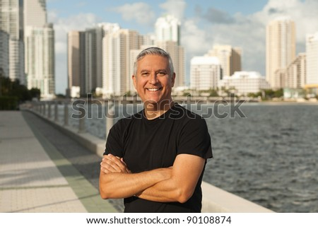 Handsome middle age man in an outdoor urban setting with Miami Biscayne Bay in the background. - stock photo