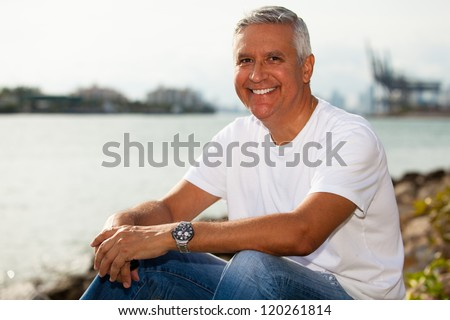 Handsome middle age man in casual clothing enjoying a Miami Beach park.