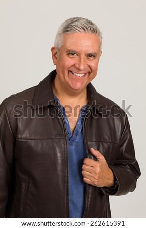 Handsome middle age man studio portrait on a light gray background. - stock photo