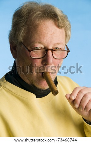 handsome middle age senior man smoking expensive cigar wearing worn turtleneck shirt portrait photo - stock photo