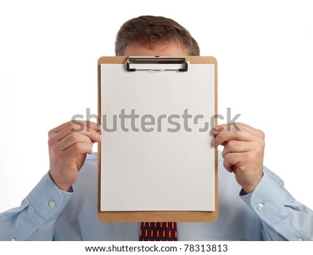 Handsome middle age successful businessman holding clip board in front of face - with clipping path for paper - stock photo