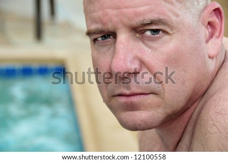 Handsome middle aged athletic man by whirlpool - stock photo