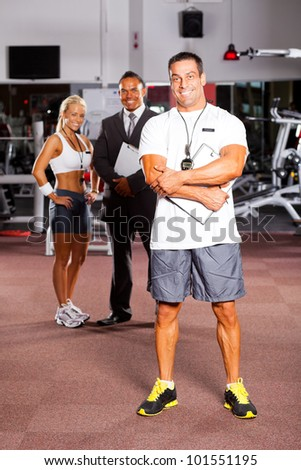 handsome middle aged trainer and colleagues - stock photo