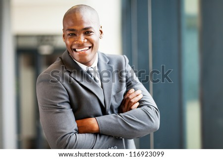 handsome modern african businessman in office - stock photo