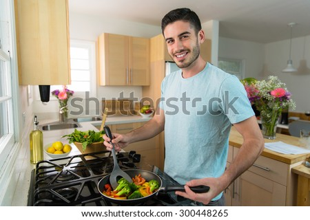 Handsome modern new model cooking portrait healthy low calorie carbs fiber - stock photo