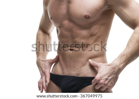 Handsome muscular bodybuilder posing on white background. High key close up studio isolated shot. Sexy male body