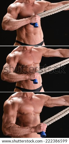 Handsome muscular bodybuilder with rope posing over black background - stock photo