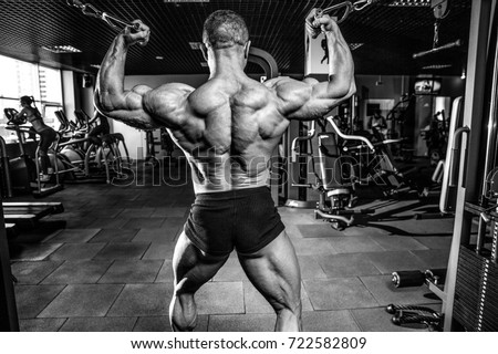 Gain stock images royalty free images vectors shutterstock handsome muscular caucasian man of model appearance working out training arms in gym gaining weight pumping ccuart Choice Image