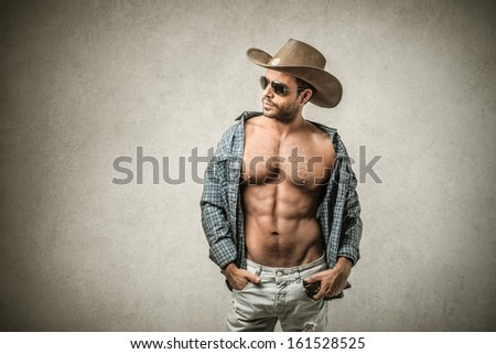 handsome muscular cowboy - stock photo