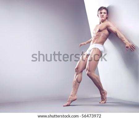 Handsome muscular guy in the studio - stock photo