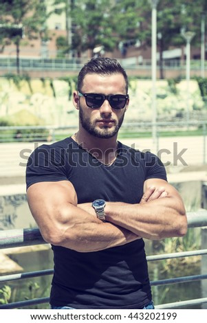 Handsome Muscular Hunk Man Outdoor in City Setting - stock photo