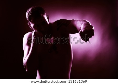 Handsome muscular man boxing - stock photo