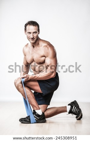 Handsome muscular man doing stretching exercise