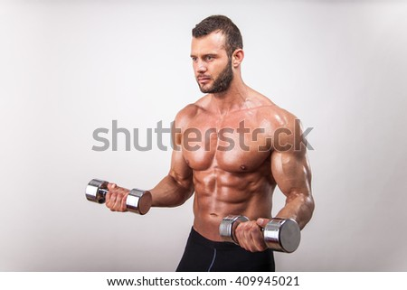 Handsome muscular man exercise with weights. - stock photo