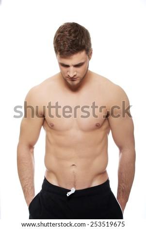 Handsome muscular man in sportswear. - stock photo