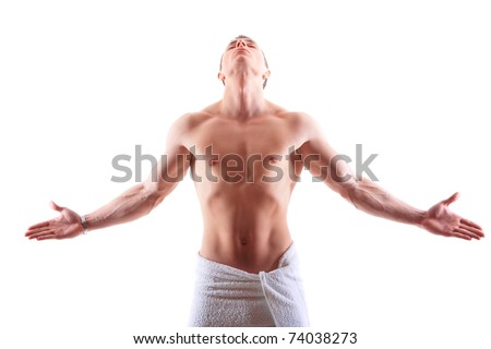Handsome muscular man in towel with open arms looking up