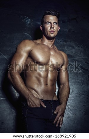Handsome muscular man posing. - stock photo