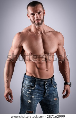 Handsome muscular man posing in studio