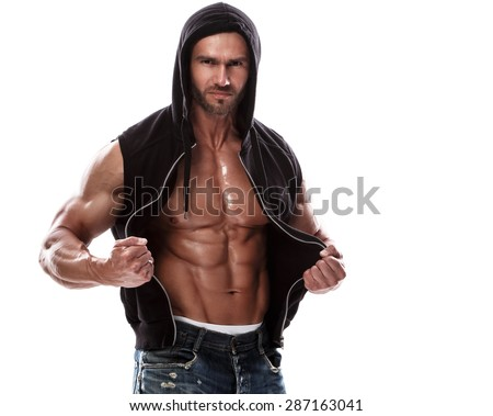 Handsome muscular man posing in studio - stock photo
