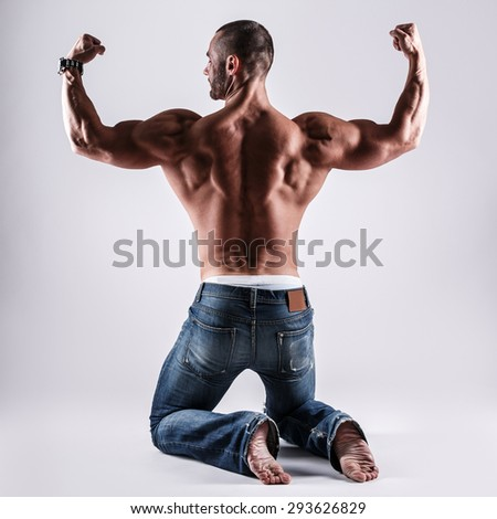 Handsome muscular man posing in studio - stock photo