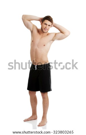 Handsome muscular man showing his well build chest. - stock photo