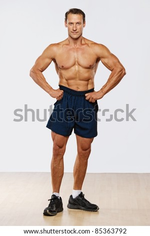 Handsome muscular man standing. - stock photo