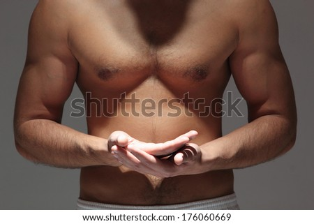 Handsome Muscular man torso with open hands  - stock photo