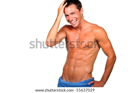 Handsome muscular man with the towel. - stock photo