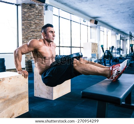 Handsome muscular man workout at crossfit gym - stock photo