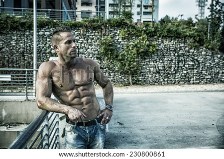Handsome Muscular Shirtless Hunk Man Outdoor in City Setting. Showing Healthy Body While Looking Away to a Side - stock photo