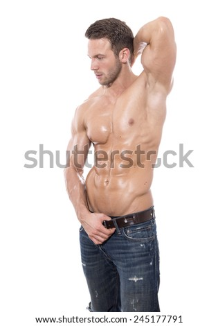 handsome muscular young man posing on isolated background as bodybuilder or fitness trainer - stock photo