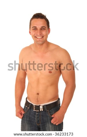 Handsome muscular young man without shirt and wearing jeans