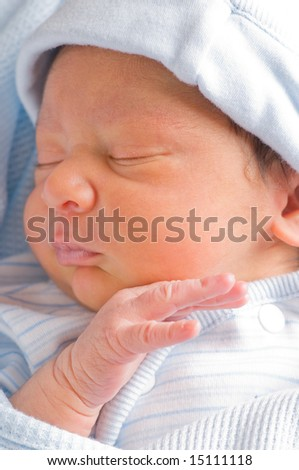 Handsome newborn baby boy sleeps quietly